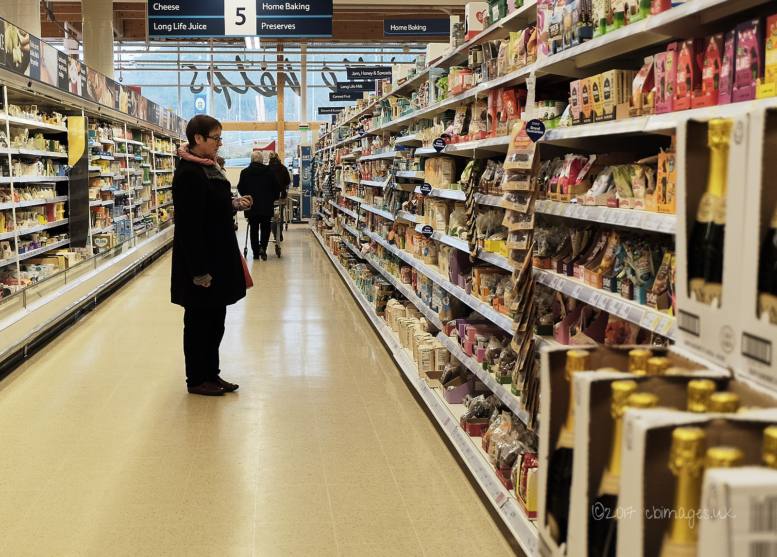 Person in a supermarket aisle