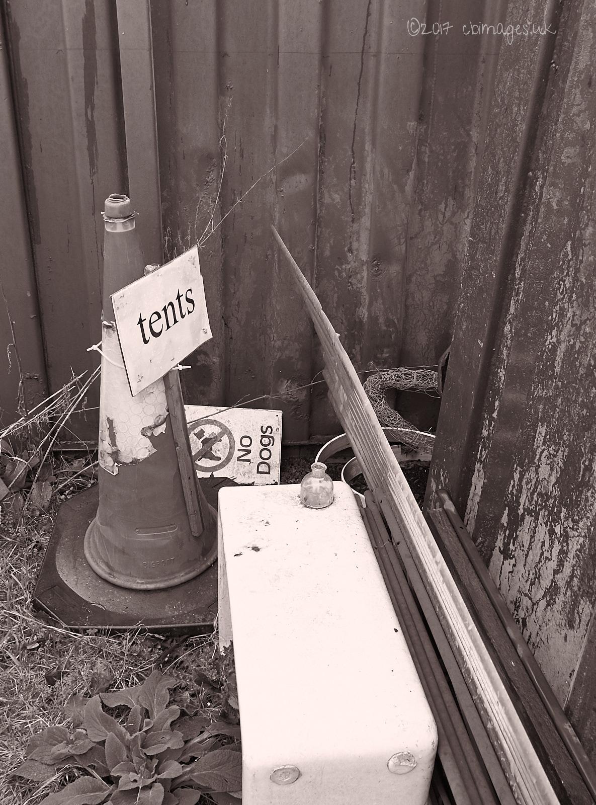 Refuse: traffic cone, signs, sink, metal etc . . .