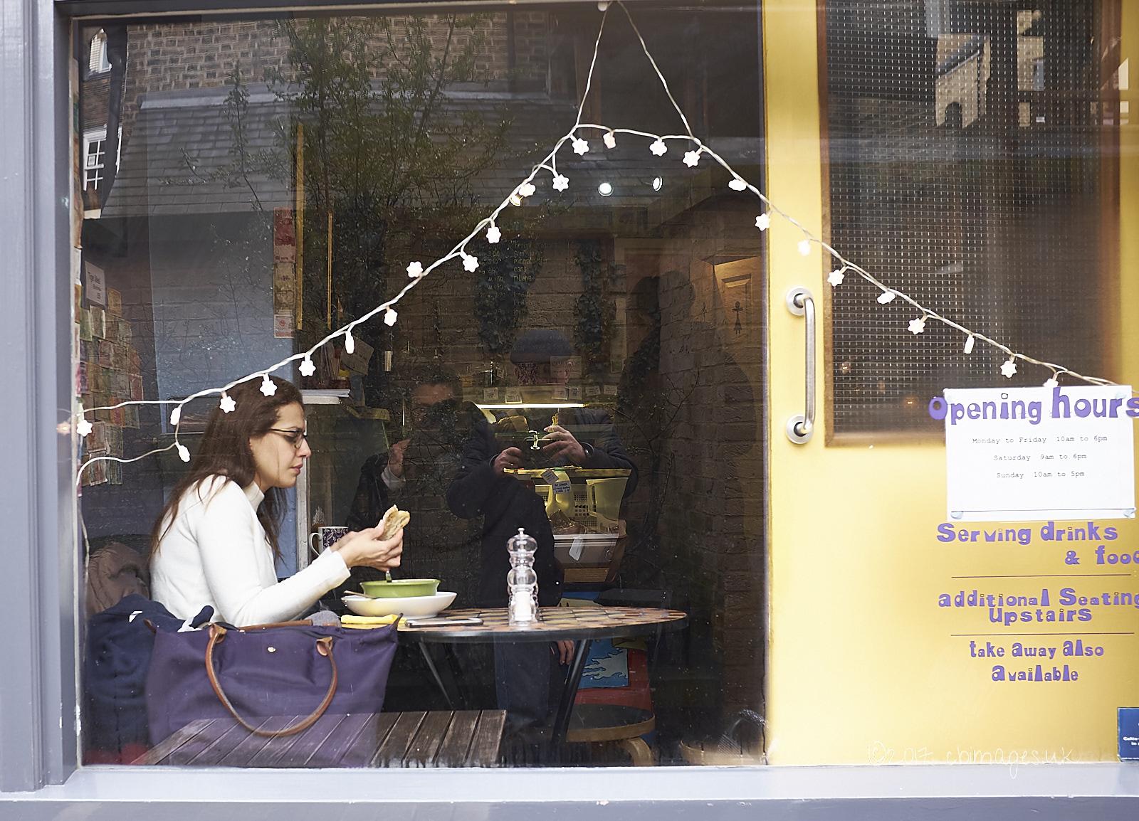 Lady in window of café