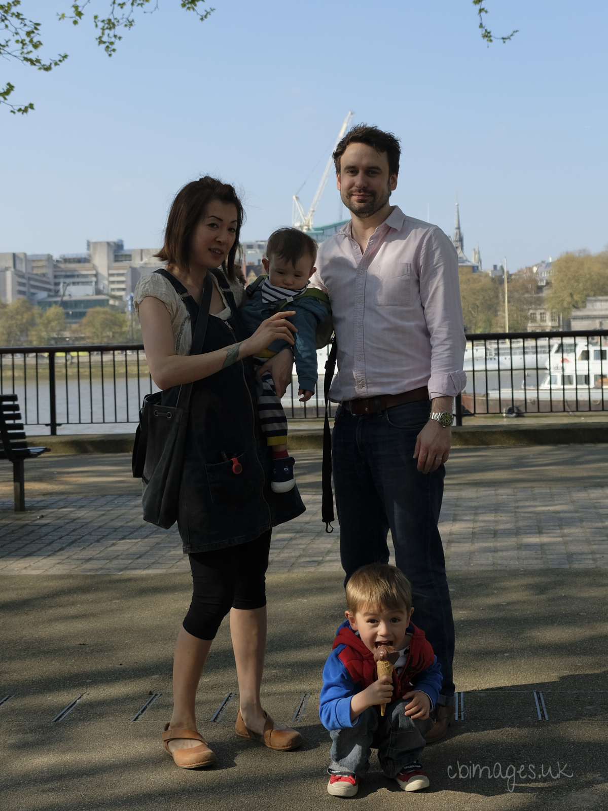 Parents with their two children next to the Thames
