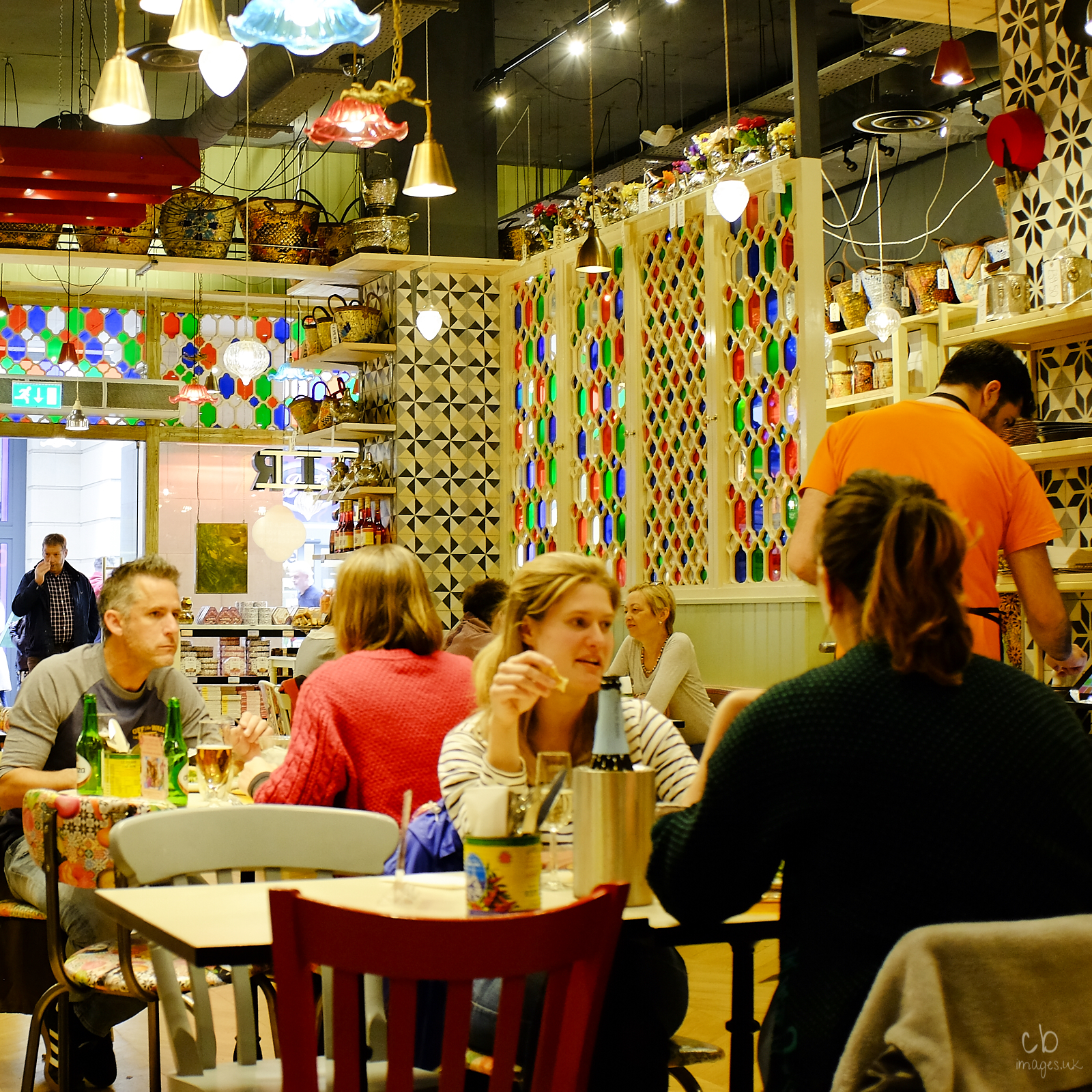 People at table in a colourful restaurant