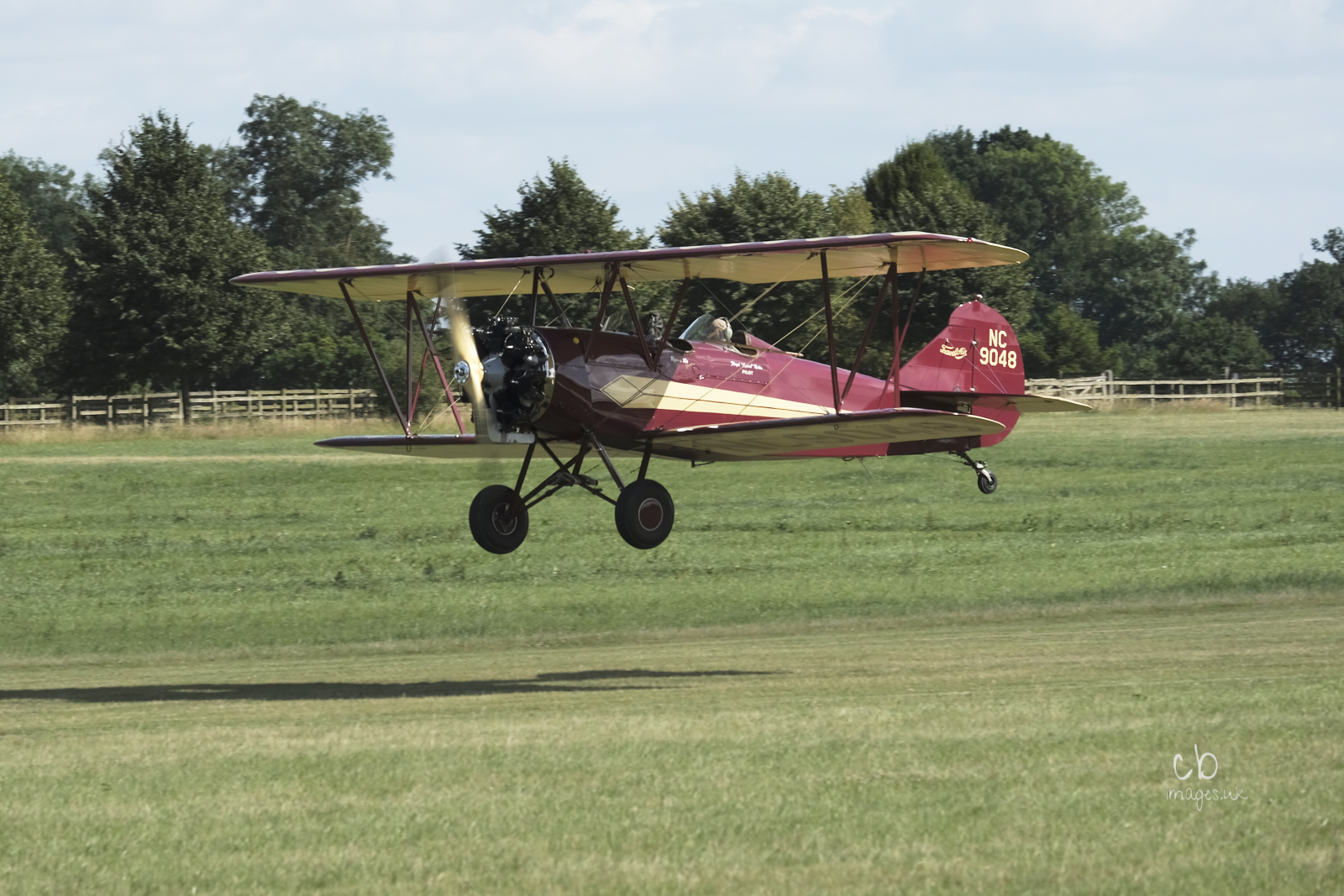 A biplane about to land