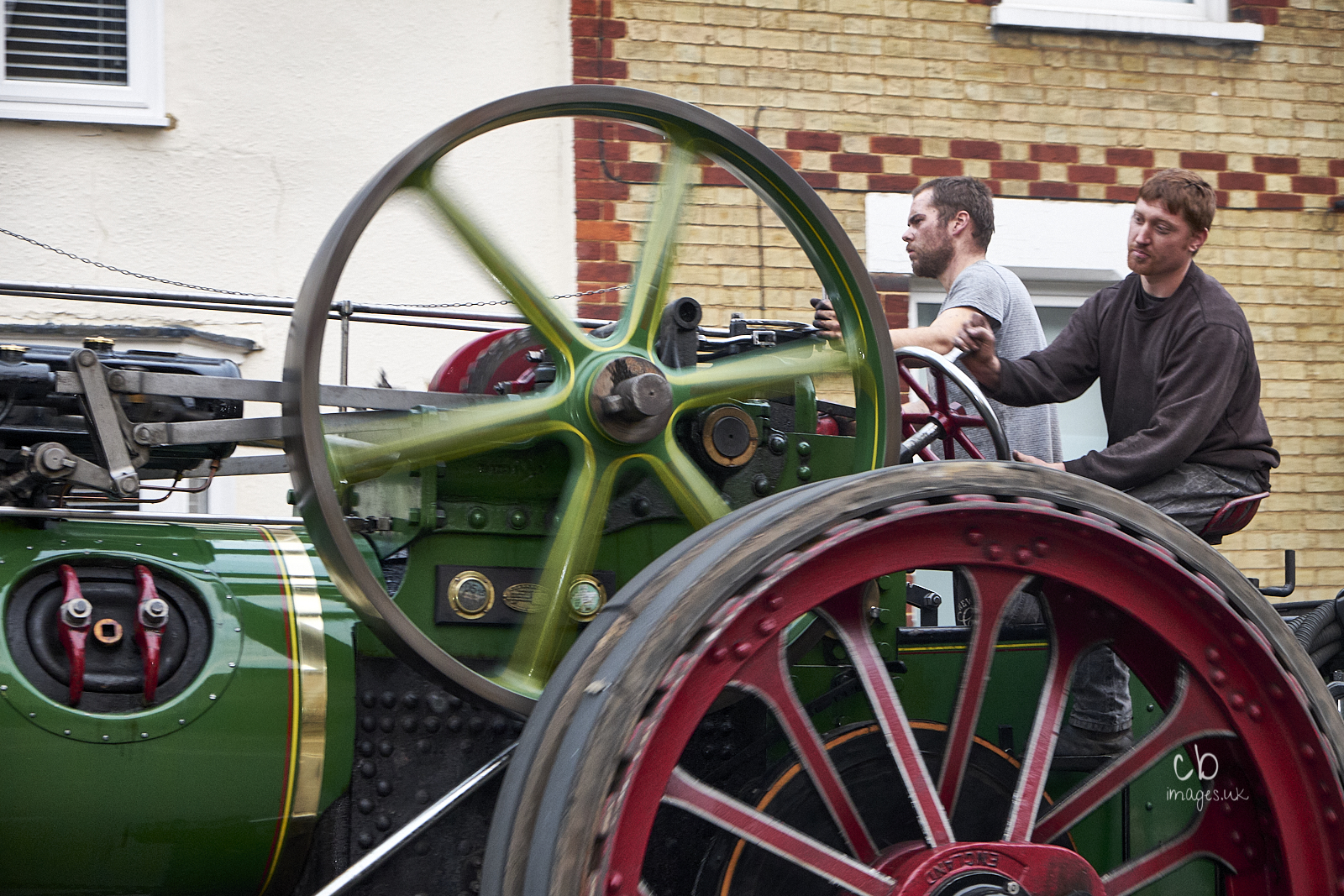 Two men operate a steam traction engine