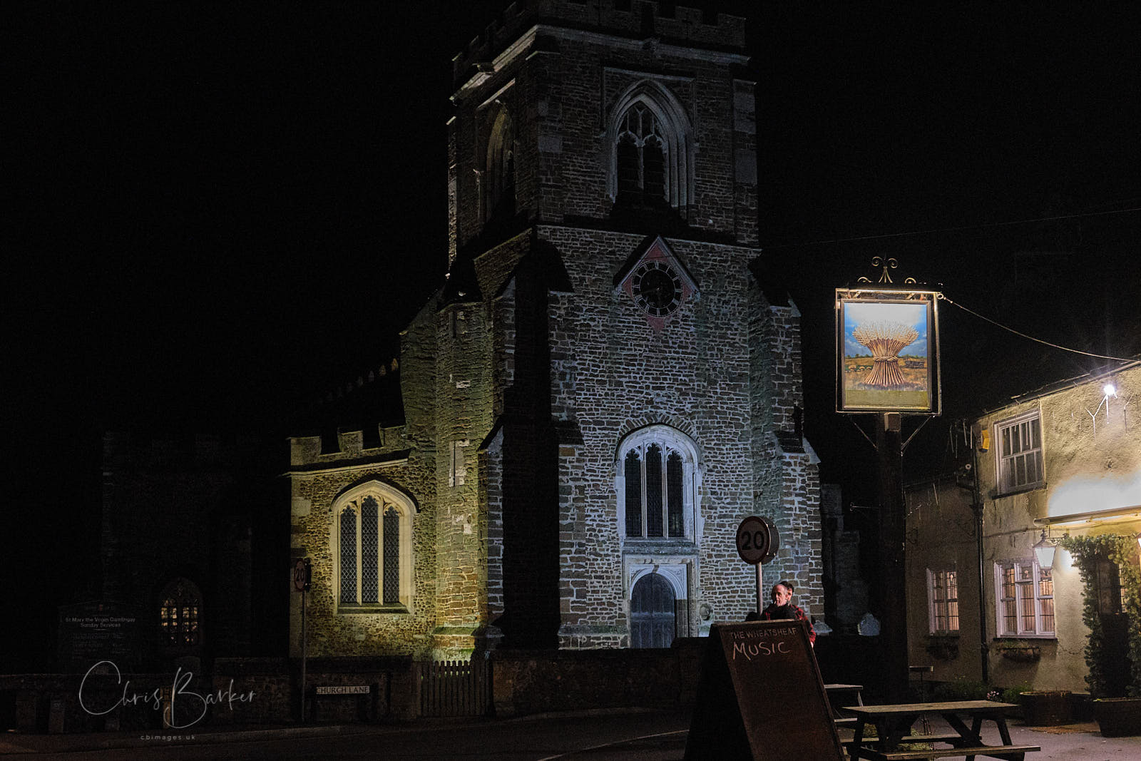 Pub and church at night