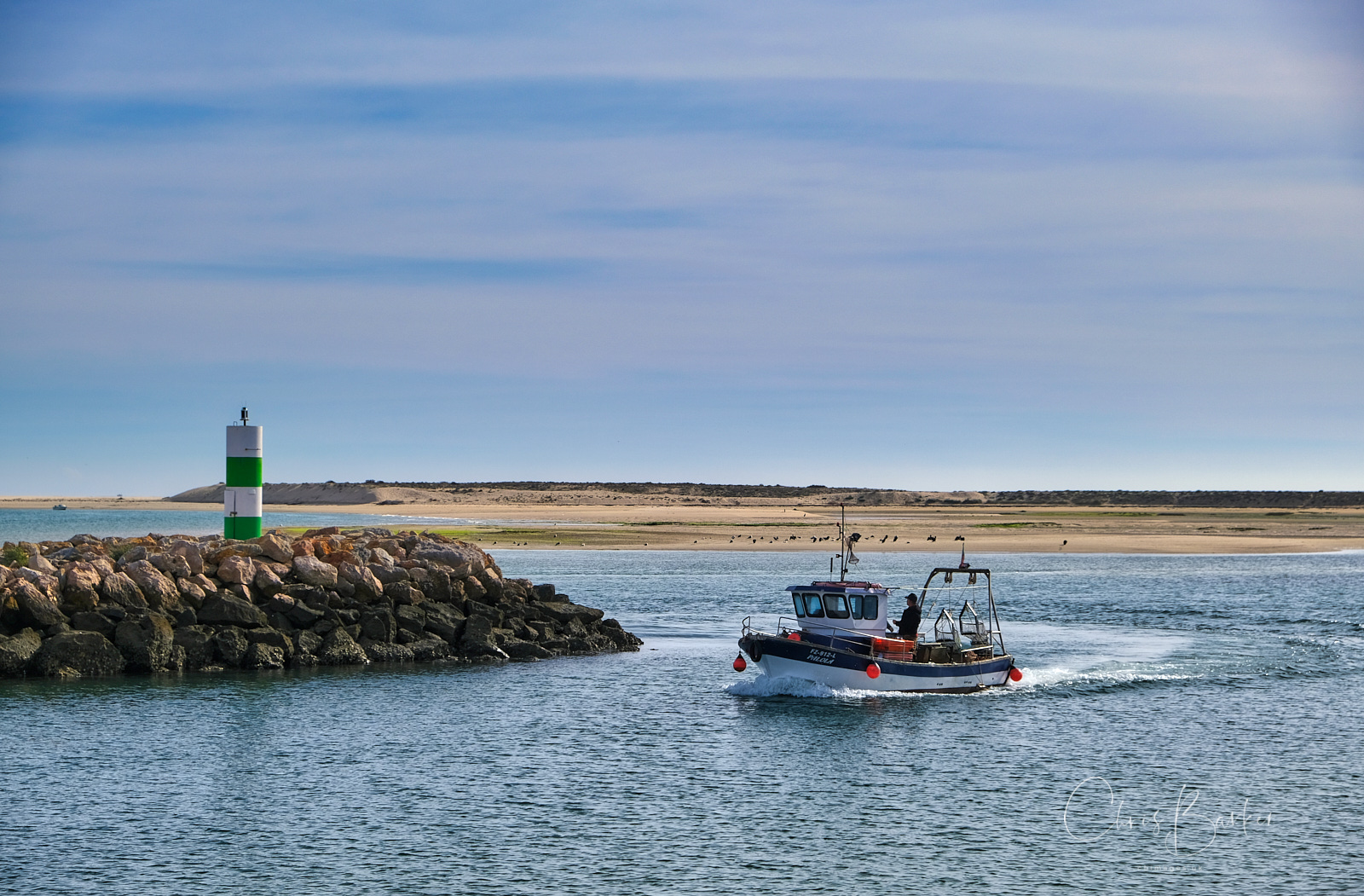 Fishing boat enters harbour