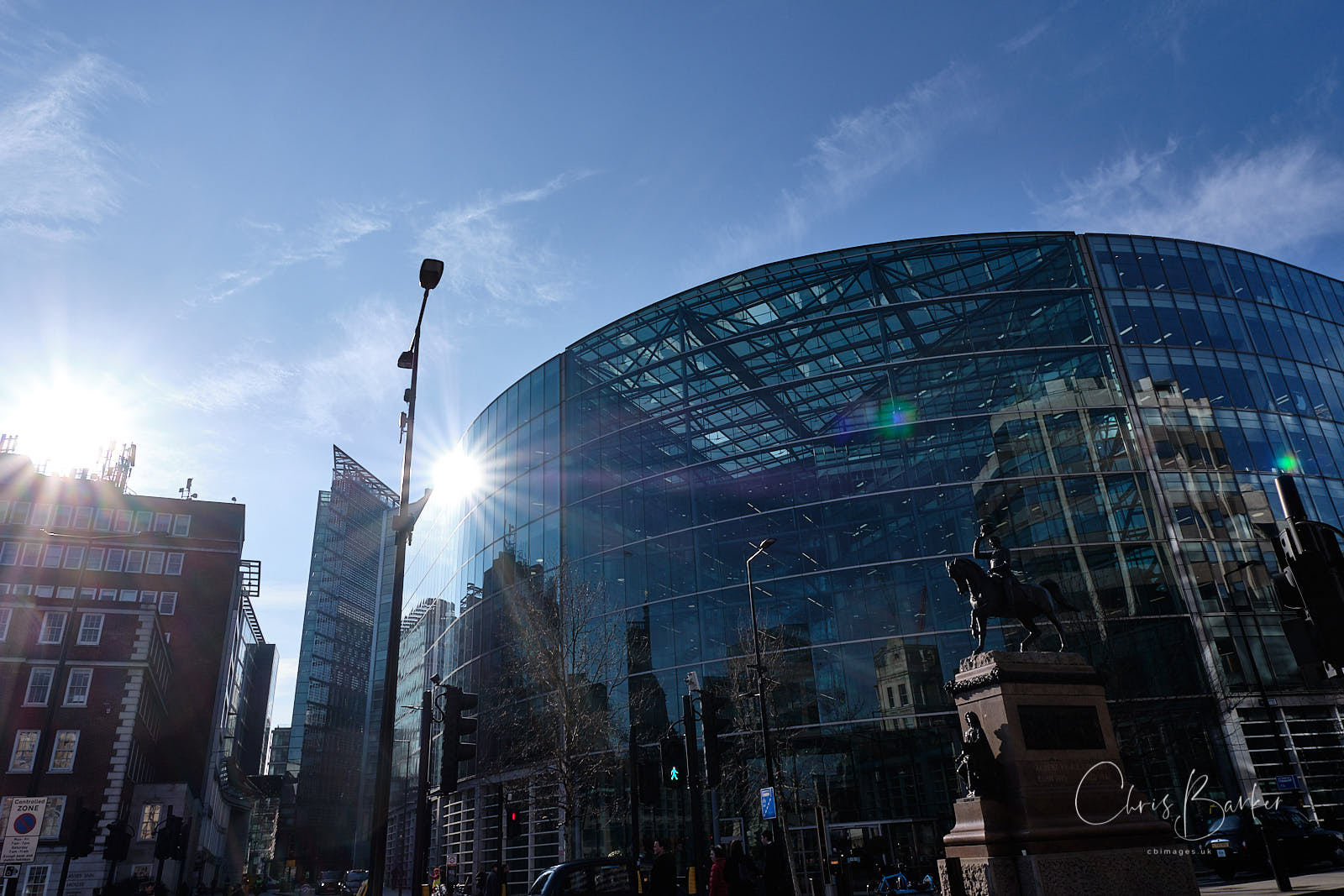Glass building in London with sun reflecting star shape