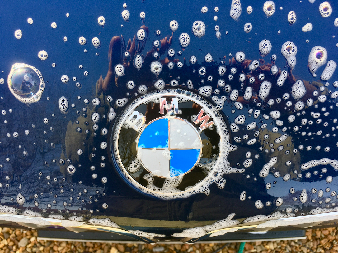 BMW car bonnet with soap suds