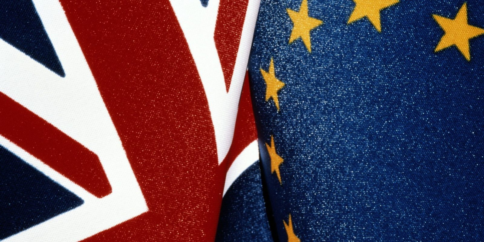 Close-up detail of Union Flag and EU flag against each other