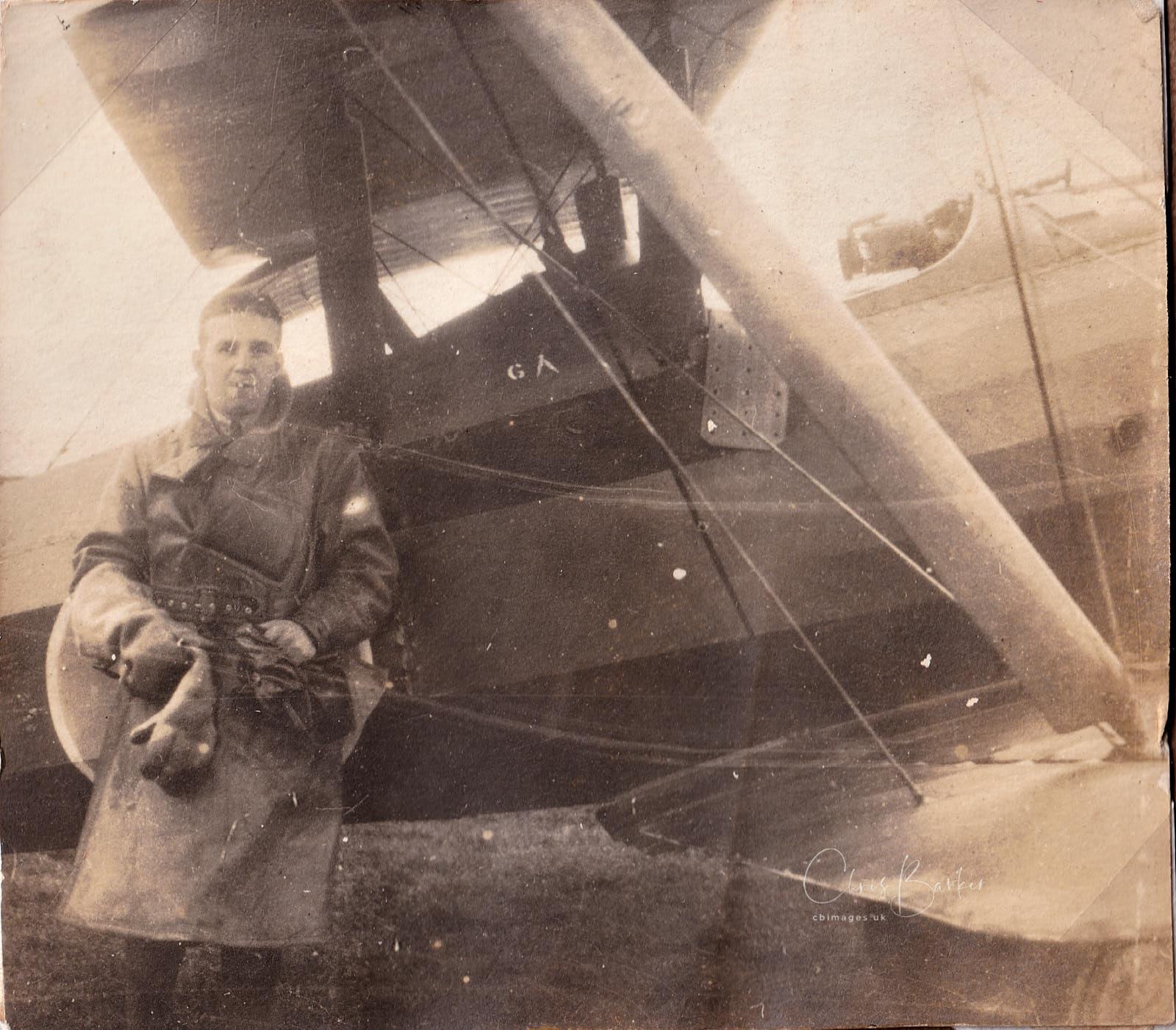 Pilot next to biplane – Harold next to a FE2b.