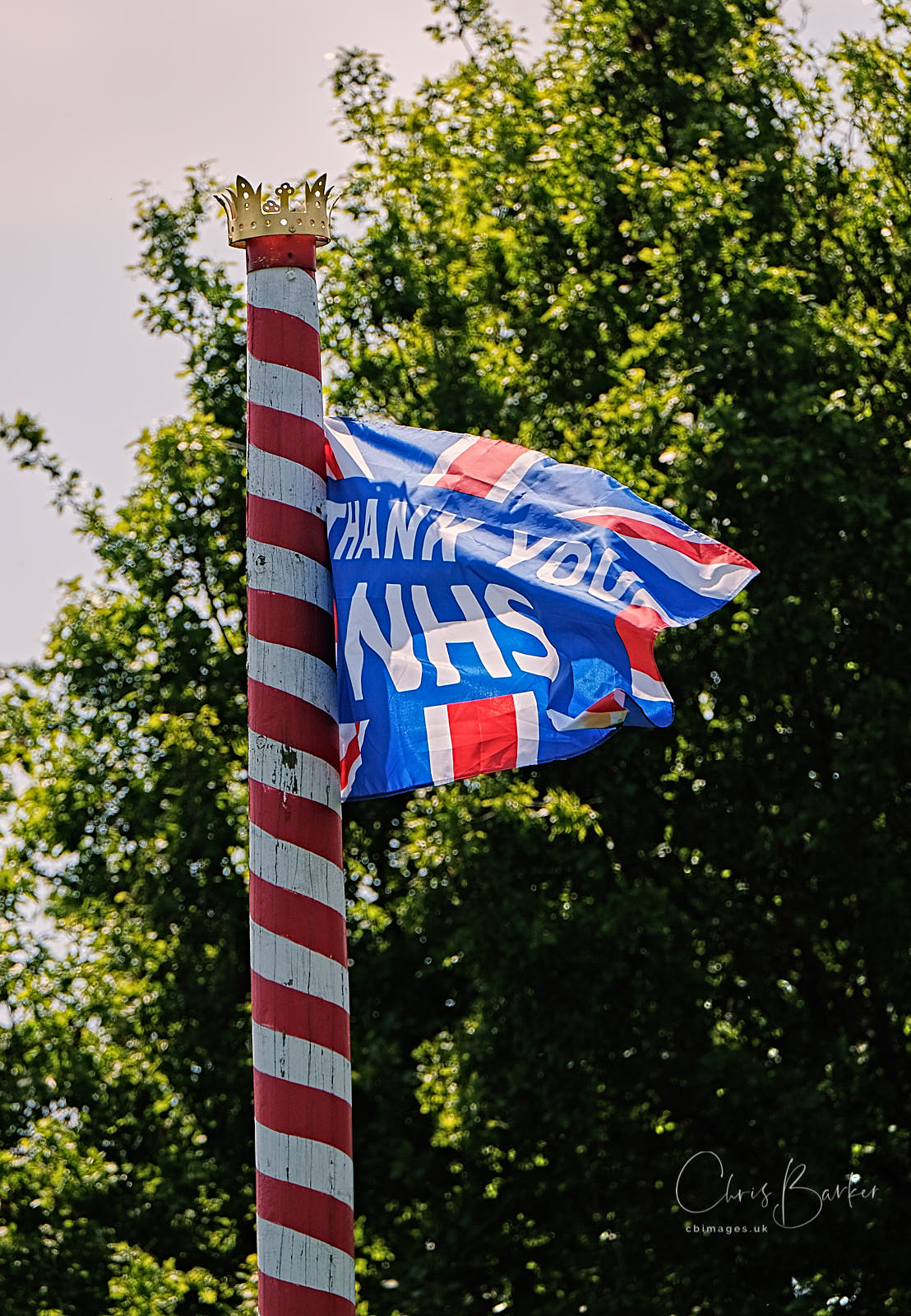 "A flag saying ""Thank you NHS"" on a maypole"
