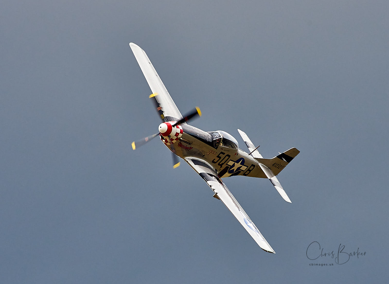 A P-51 Mustang flying towards the camera