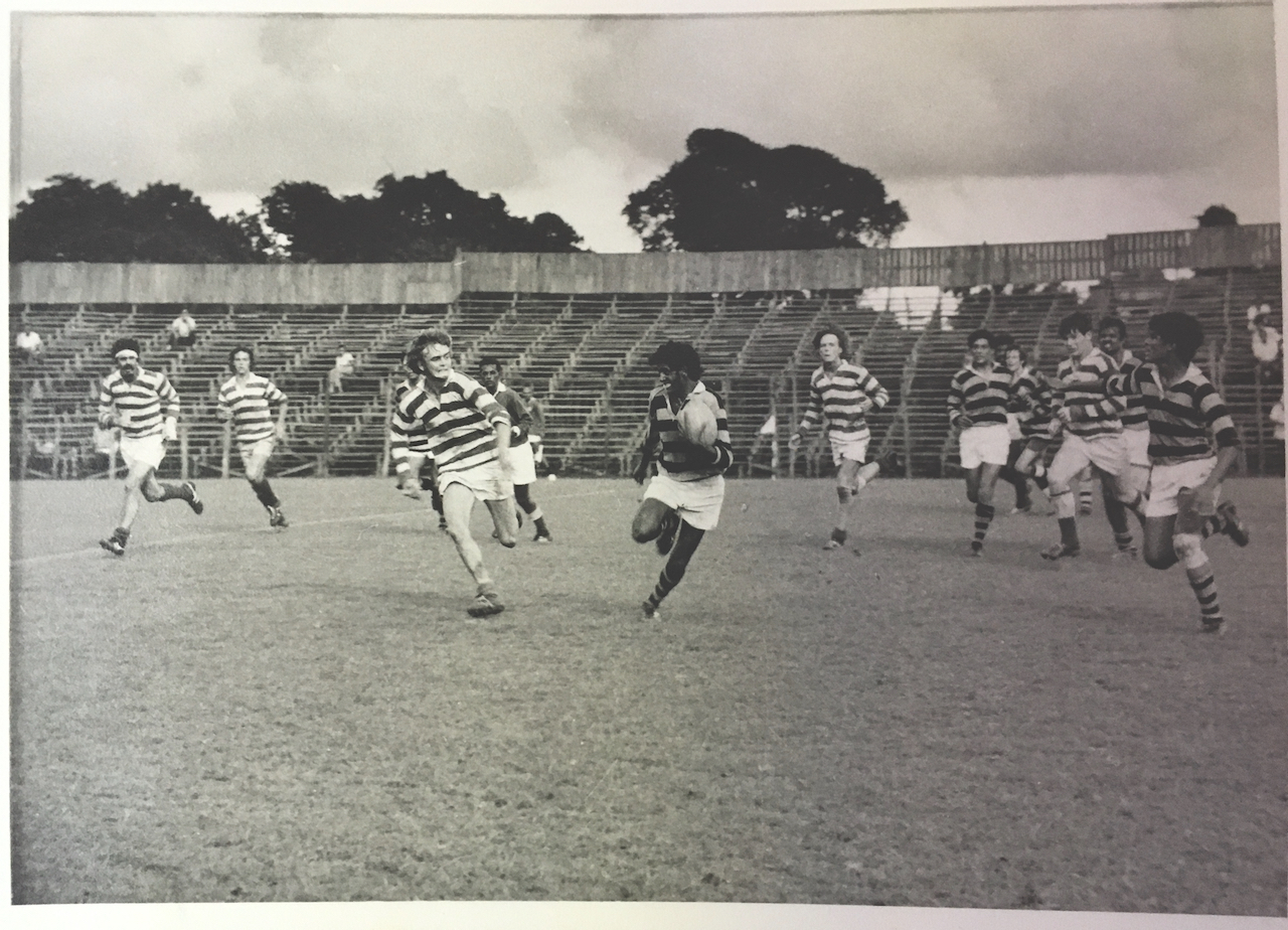 Monochrome image of amateur rugby action