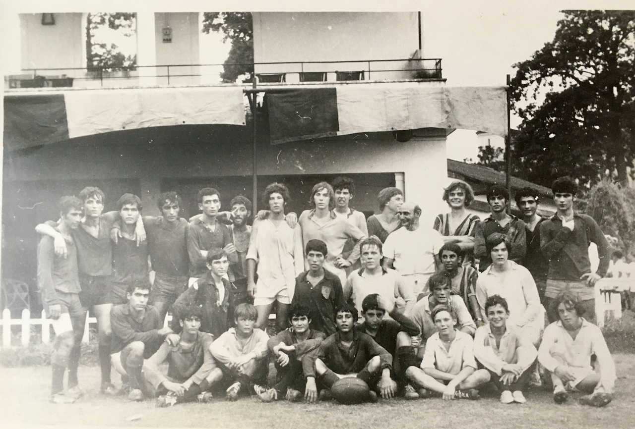 Rugby teams pose in monochrome photo